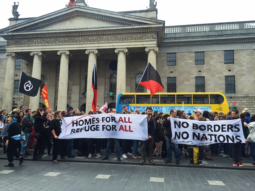 No Borders No Nation banner and Homes for all Refuge for all banners at GPO Dublin for Refugees are Welcome protest